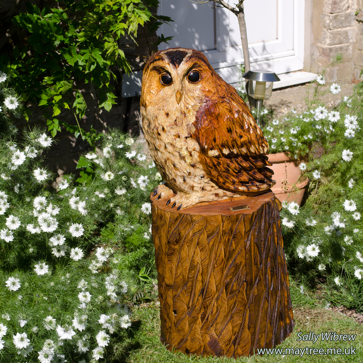 Chainsaw carved owl sculpture year of clean water